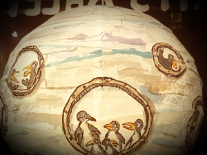 Drawing of a group of penguins inside a sphere ice submarine, painted on rice paper lamp. art by Frits Ahlefeldt