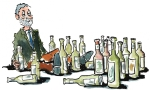 Man sitting depressed between a lot of bottles