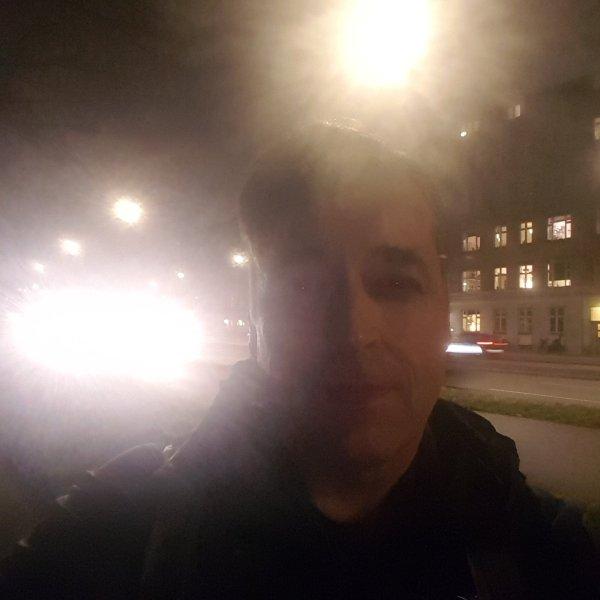 Frits Ahlefeldt, walking on road, photo