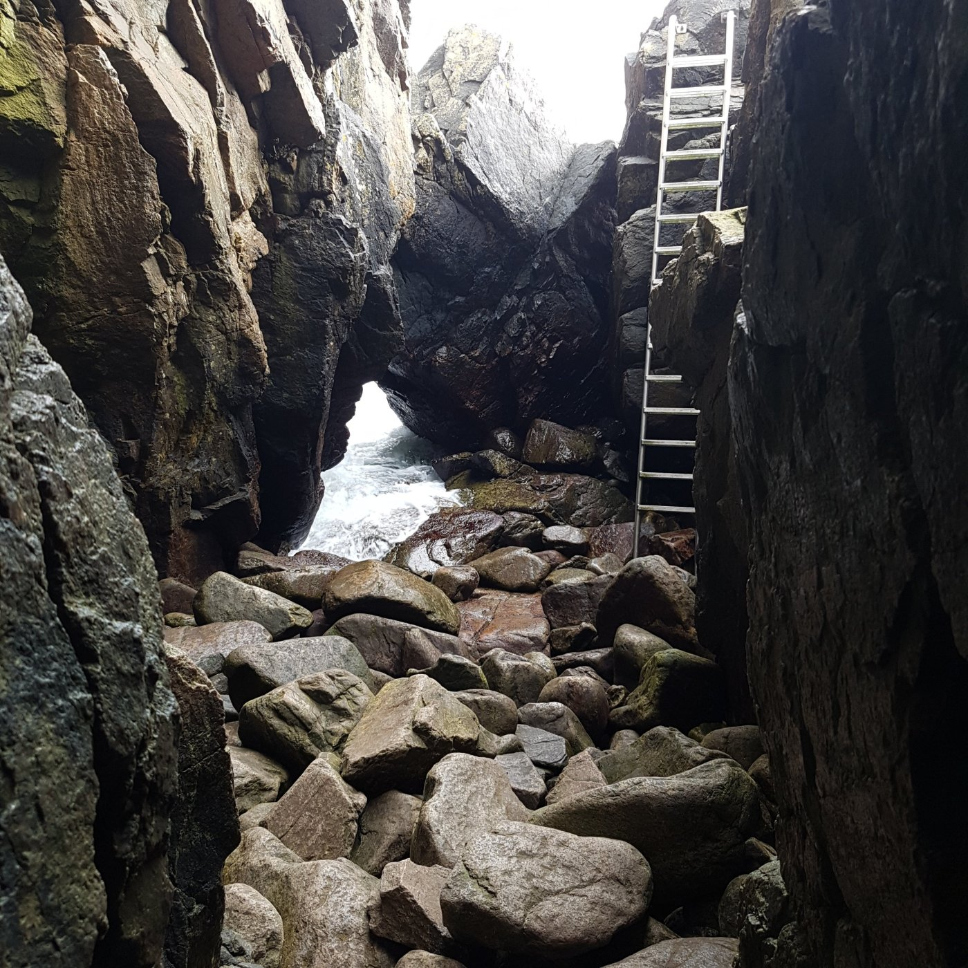 Photo of cave exit along the Bornholm Coast trail, photo by Frits Ahlefeldt